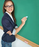 Smiling student or teacher writing on blackboard. Stock Photo