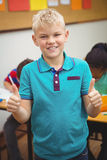 Smiling student with thumbs up. At the elementary school Stock Images