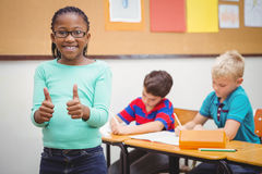 Smiling student with thumbs up. At the elementary school Stock Photos