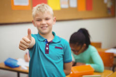 Smiling student with thumbs up. At the elementary school Royalty Free Stock Images
