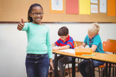 Smiling student with thumbs up. At the elementary school Royalty Free Stock Photos