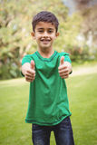 Smiling student with thumbs up. On the school grounds Royalty Free Stock Photos