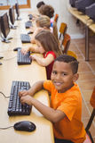 Smiling student using a computer. At the elementary school Stock Photo