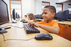 Smiling student using a computer. At the elementary school Royalty Free Stock Images