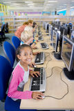 Smiling student using computers in school computer lab Stock Images