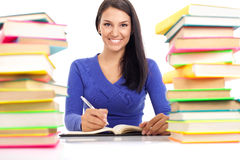 Smiling student wit lot of books Stock Photos