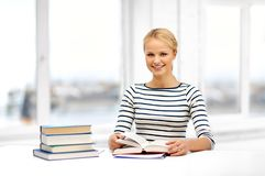 Smiling student woman with books learning at home. Education, school and learning concept - smiling student woman with books at home stock photos