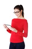 Smiling student woman in eyewear using a tablet Royalty Free Stock Photography