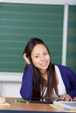 Smiling student working with digital pad Royalty Free Stock Photography