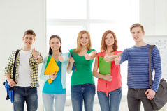 Smiling students with bags and folders at school Stock Photography