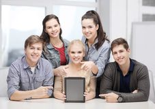 Smiling students with blank tablet pc screen Stock Photography
