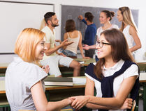 Smiling students during break in classroom. Smiling adult students during break in classroom Stock Image