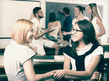 Smiling students during break in classroom. Smiling adult students during break in classroom Royalty Free Stock Images