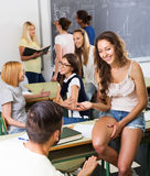 Smiling students during break in classroom Stock Photo