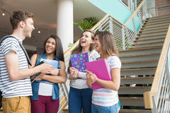 Smiling students chatting together outside Stock Photography