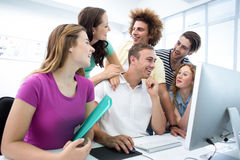 Smiling students in computer class Royalty Free Stock Photography