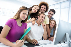 Smiling students in computer class Royalty Free Stock Photo