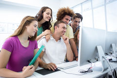 Smiling students in computer class Royalty Free Stock Image