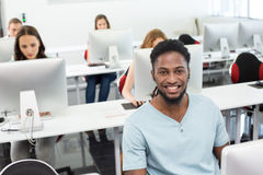 Smiling students in computer class. Portrait of smiling students in computer class Royalty Free Stock Photography