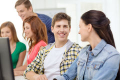 Smiling students in computer class at school Royalty Free Stock Photography