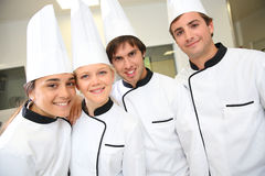 Smiling students in cooking class royalty free stock photos