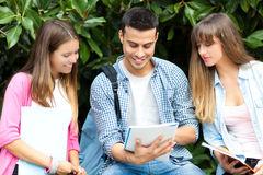 Smiling students group reading books Royalty Free Stock Photos