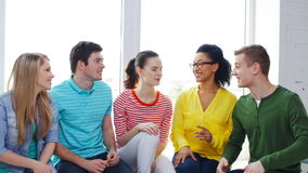 Smiling students having conversation at school stock footage
