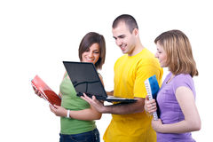 Smiling students with laptop. Young students with books and laptop on white background Royalty Free Stock Photos