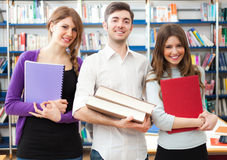 Smiling students in a library. Group of students in a library Stock Photography