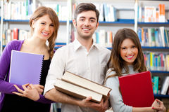 Smiling students in a library. Group of students in a library Stock Images