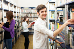 Smiling students in a library Stock Photo