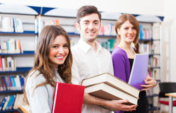 Smiling students in a library Stock Images