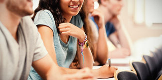 Smiling students listening lecturer Royalty Free Stock Image