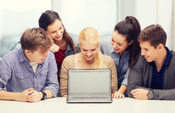 Smiling students looking at blank lapotop screen Royalty Free Stock Image