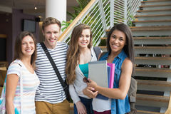 Smiling students looking at camera outside Stock Photography