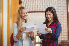 Smiling students looking at results Royalty Free Stock Photos