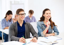 Smiling students with notebooks at school Royalty Free Stock Photography