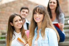 Smiling students outdoor Stock Photography
