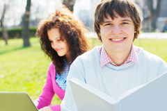 Smiling students outdoors Royalty Free Stock Photos