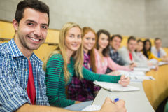 Smiling students in a row at the lecture hall Royalty Free Stock Photography