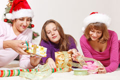 Smiling students in Santa hats Royalty Free Stock Photography