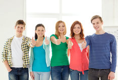 Smiling students at school showing thumbs up Royalty Free Stock Photography