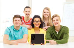 Smiling students showing tablet pc blank screen Royalty Free Stock Photo