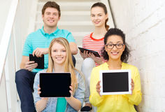 Smiling students showing tablet pc blank screen Stock Images