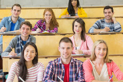 Smiling students sitting at the lecture hall Royalty Free Stock Photography