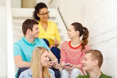 Smiling students with smartphone having discussion Stock Photography