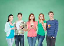 Smiling students with smartphones Stock Image