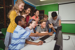 Smiling students studying together in computer classroom Royalty Free Stock Photos