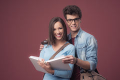 Smiling students studying together Royalty Free Stock Photography