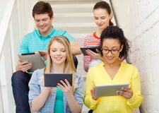 Smiling students with tablet pc computer Stock Image